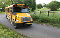 NWA Democrat-Gazette/DAVID GOTTSCHALK A Farmington Public Schools bus turns Tuesday, May 7, 2019, onto Gibson Hill Road from Wesley Stevens Road. Washington County is working with local school districts to identify and improve some of the narrow, dangerous county roads that double as bus routes.