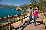 Portraits of mixed race couple walking and holding hands at sand harbor, lake tahoe.
