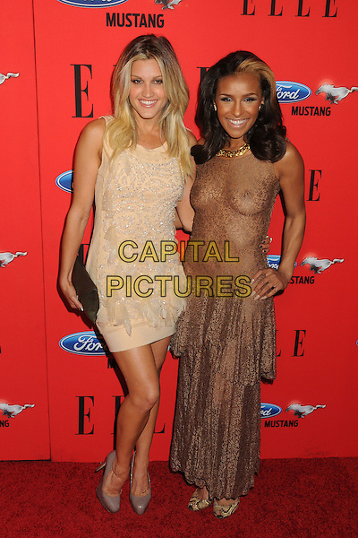 Ashley Roberts & Melody Thornton.3rd Annual Women in Music 2012 Event held at Avalon, Hollywood, California, USA..April 11th, 2012.full length dress hand on hip cream silver beads beaded black clutch bag beige brown see through thru nipples cleavage flashing lace peplum.CAP/ADM/BP.©Byron Purvis/AdMedia/Capital Pictures.