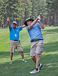 Steve Young, NFL Hall of Fame QB, hits an approach shot at the Edgewood Tahoe Golf Course during the American Century Championship on Wednesday, July 16, 2014.