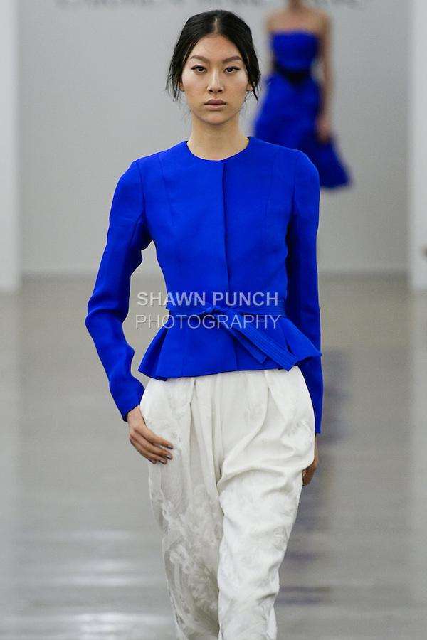 Shu Yang walks runway in an outfit from the Carmen Marc Valvo Spring 2013 collection fashion show, during Mercedes-Benz Fashion Week Spring 2013.