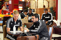 Wednesday 07 August 2013<br /> Pictured L-R: Team mates Garry Monk and Leon Britton at Cardiff Airport.<br /> Re: Swansea City FC travelling to Sweden for their Europa League 3rd Qualifying Round, Second Leg game against Malmo.