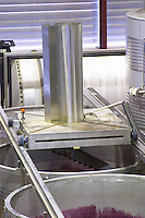 Mechanical pigeur, for pushing down the cap, pigeage. Lagares, Portuguese low and wide maceration vats. Herdade das Servas, Estremoz, Alentejo, Portugal
