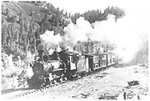 RGS 4-6-0 #20 hauling stock cars in a canyon.<br /> RGS  Burns Canyon ?, CO