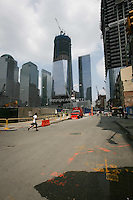 Tenth anniversary of 9/11.  Rebuilding at the World Trade Center site.  The view from Greenwich Street north to Ground Zero.  L to R: World Financial Center buildings, Goldman Sachs, under-construction 1 WTC, 7 WTC, and under-construction 4 WTC.  When the site is rebuilt Greenwich Street will once again be a thoroughfare through the site.  The previous World Trade Center bisected the street.  Photo by Ari Mintz.  8/7/2011.