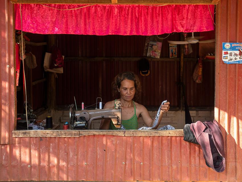 A women tailer along the rural road outside Battambang, Cambodia