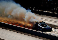 Sept. 18, 2010; Concord, NC, USA; NHRA funny car driver Ashley Force Hood does a burnout during qualifying for the O'Reilly Auto Parts NHRA Nationals at zMax Dragway. Mandatory Credit: Mark J. Rebilas /