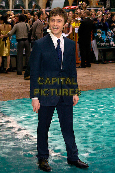 "DANIEL RADCLIFFE.Arrivals - ""Harry Potter and the Order of the Phoenix"" European premiere, Odeon cinema, Leicester Square London, England..July 3rd, 2007.full length tie suit white shirt blue pinstripe mouth open.CAP/CAN.©Can Nguyen/Capital Pictures"