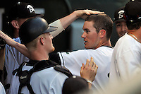 Right fielder Jaden Savage (19) of the USC Upstate Spartans is congratulated after scoring a run in a game against the South Carolina Gamecocks on Tuesday, March 15, 2016, at Fluor Field at the West End in Greenville, South Carolina. (Tom Priddy/Four Seam Images)
