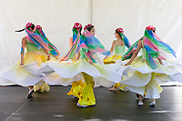 Girls dancing Chinese Hats and Scarfs Dance, Northwest Folklife Festival 2016, Seattle Center, Washington, USA.