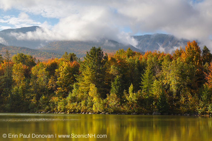 Northern Presidential Range engulfed in clouds and fog from Durand Lake in Randolph, New Hampshire during the autumn months.