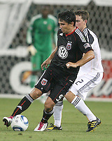 Jaime Moreno #99 of D.C. United dribbles past Todd Dunivant #2 of the Los Angeles Galaxy during an MLS match at RFK Stadium on July 18 2010, in Washington D.C. Galaxy won 2-1.