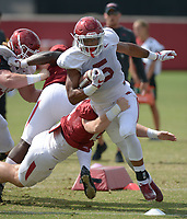 NWA Democrat-Gazette/ANDY SHUPE<br /> Arkansas running back Rakeem Boyd carries the ball Thursday, Aug. 9, 2018, during practice at the university's practice facility in Fayetteville. Visit nwadg.com/photos to see more photos from practice.
