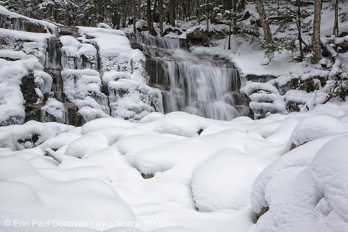 Stairs Falls in Franconia Notch State Park of the New Hampshire White Mountains covered in snow. This waterfall is located along the Falling Waters Trail.