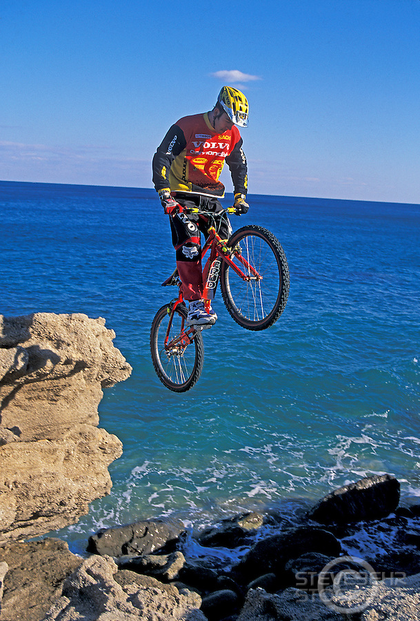 Martyn Ashton jumping between rocks next to sea , nr Mojacar Spain 1997.pic copyright Steve Behr / Stockfile