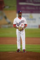 Auburn Doubledays relief pitcher Joan Adon (24) gets ready to deliver a pitch during a game against the Hudson Valley Renegades on September 5, 2018 at Falcon Park in Auburn, New York.  Hudson Valley defeated Auburn 11-5.  (Mike Janes/Four Seam Images)