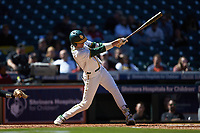Kyle Nevin (23) of the Baylor Bears follows through on his swing against the Missouri Tigers in game one of the 2020 Shriners Hospitals for Children College Classic at Minute Maid Park on February 28, 2020 in Houston, Texas. The Bears defeated the Tigers 4-2. (Brian Westerholt/Four Seam Images)