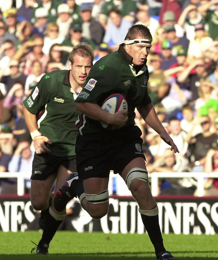 Photo Peter Spurrier.29/09/2002.Zurich Premiership Rugby - London Irish v Wasps.Exiles skipper Ryan Strudwick supported by Paul Gustgard runs at the Wasps defence.