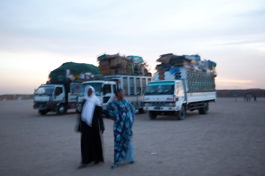 5 january 2011 - Khartoum, Sudan - Southern Sudanese people in the North load their belongings on a truck as they prepare to leave for the South before the secession referendum, in an area called Soba in Khartoum. The referendum, guaranteed by a 2005 peace deal between north and south which ended Africa's longest civil war, is forecast to result in secession, but exactly how the two countries will begin to disentangle their economies, resources and people is far from clear. Photo credit: Benedicte Desrus