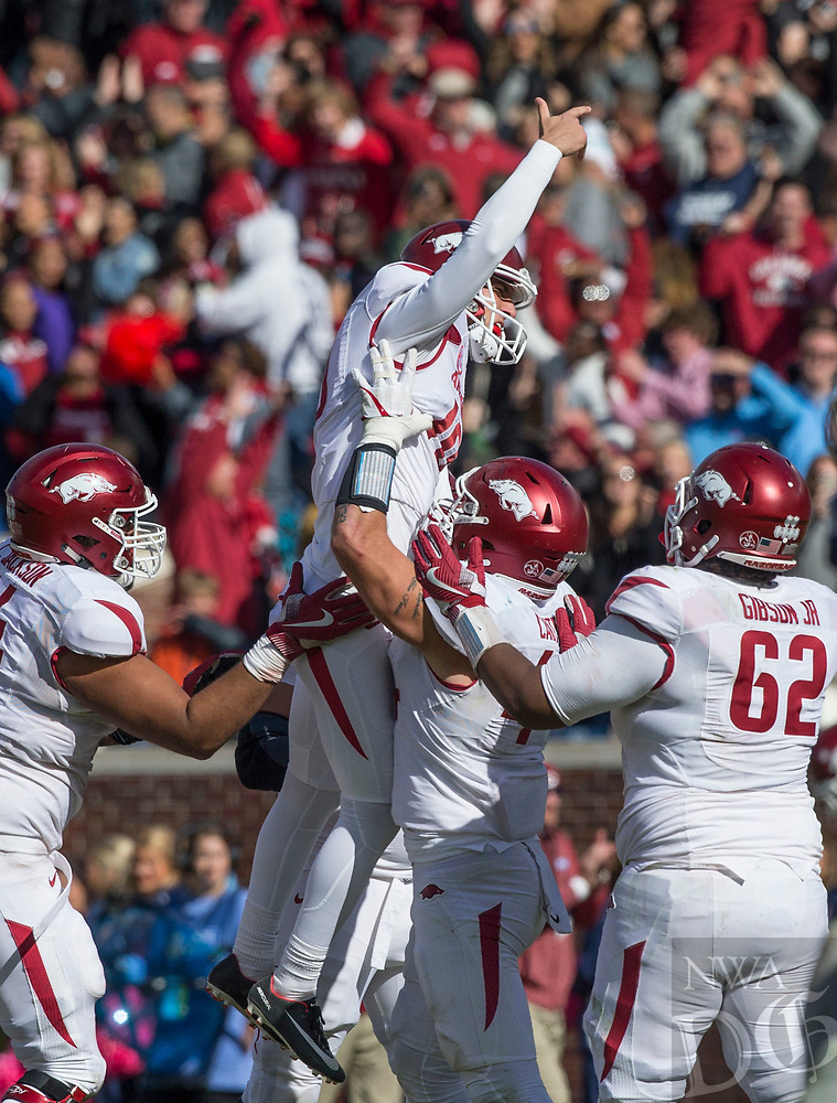 Hawgs Illustrated/BEN GOFF <br /> Connor Limpert, Arkansas kicker, jumps into the arms of his teammates after kicking a field goal late in the fourth quarter to defeat Ole Miss Saturday, Oct. 28, 2017, at Vaught-Hemingway Stadium in Oxford, Miss.