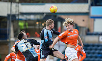 Cameron McGeehan of Luton Town beats Jason McCarthy of Wycombe Wanderers in the air during the Sky Bet League 2 match between Wycombe Wanderers and Luton Town at Adams Park, High Wycombe, England on 6 February 2016. Photo by Andy Rowland.