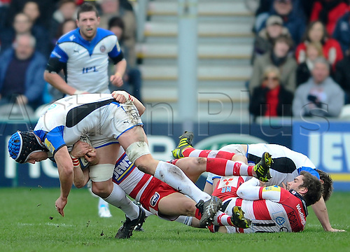 05.03.2011 Aviva Premiership Rugby Union from Kingsholm Stadium. Gloucester Rugby v Bath Rugby. Bath Flanker (#6) Ben Skirving is tackled by Gloucester Fly-Half (#10) Nicky Robinson in the first half