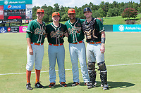 (L-R) Greensboro Grasshoppers pitchers Michael Mertz (25), Taylor Braley (10), and Jeremy Ovalle (29) combined with catcher Will Allen (33) on a 7-inning no-hitter against the Kannapolis Intimidators at Kannapolis Intimidators Stadium on August 5, 2018 in Kannapolis, North Carolina.  The Grasshoppers defeated the Intimidators 2-1 in game one of a double-header.  (Brian Westerholt/Four Seam Images)