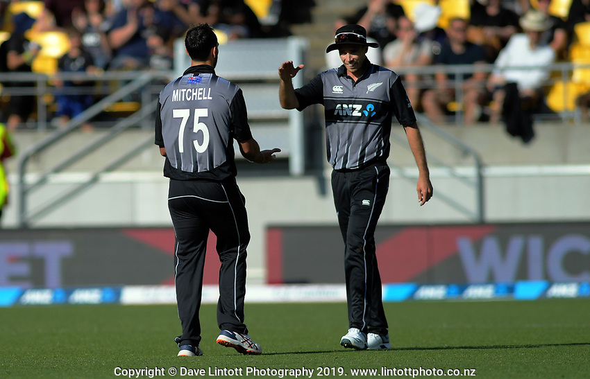 NZ captain Tim Southee (right) congratulates Daryl Mitchell on taking the final wicket. Twenty20 International cricket match between NZ Black Caps and England at Westpac Stadium in Wellington, New Zealand on Sunday, 3 November 2019. Photo: Dave Lintott / lintottphoto.co.nz