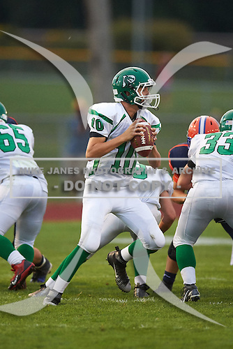 Pembroke Dragons quarterback Reid Miano (10) drops back to pass against the Attica Blue Devils at Attica Central School on September 11, 2015 in Attica, New York.  Attica defeated Pembroke 36-0.  (Copyright Mike Janes Photography)