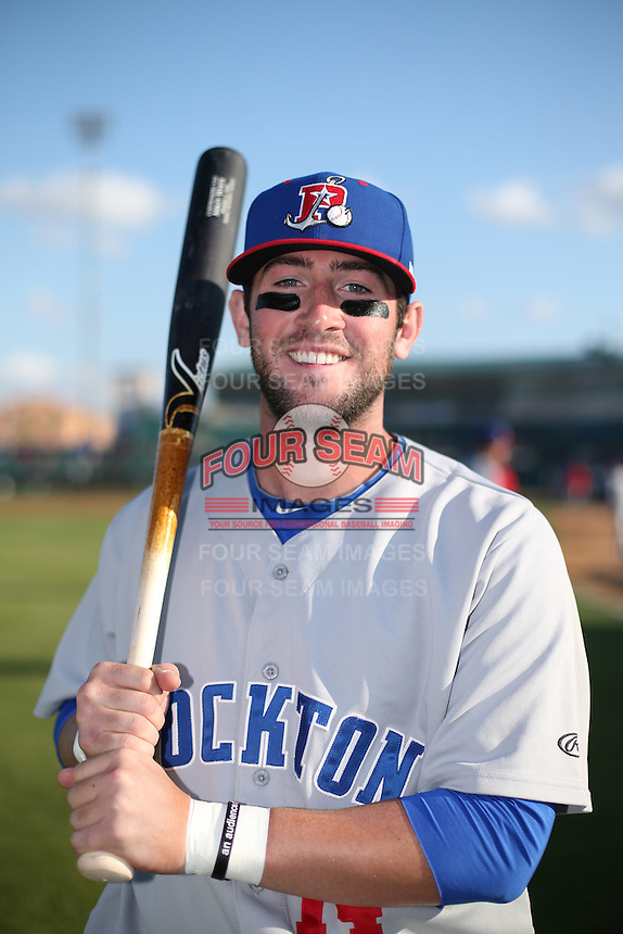 Mikey White (14) of the Stockton Ports poses for a photo before a game against the Lancaster JetHawks at The Hanger on May 26, 2016 in Lancaster, California. Stockton defeated Lancaster, 16-7. (Larry Goren/Four Seam Images)