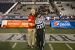 New Mexico head coach Bob Davie talks with a referee in the second half of an NCAA college football game against Nevada in Reno, Nev., Saturday, Nov. 2, 2019. (AP Photo/Tom R. Smedes)