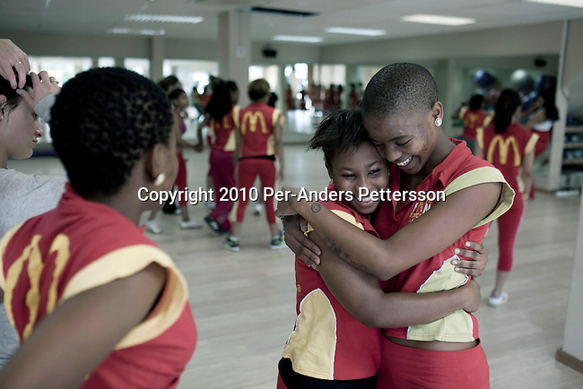 JOHANNESBURG, SOUTH AFRICA - MAY 9: Manthe Ribane (r), age 22, a dancer, trains with fellow girls in a dance studio on May 9, 2010, Johannesburg, South Africa. She will perform at the opening ceremony and other games during the FIFA World Cup held in South Africa between June 11 to July 11, 2010. A part time model, dancer and artist, she is one of the young black South Africans who has received more opportunities than their parents. In hosting the largest sporting event in the world, South Africa has a chance to impress the world with their country, hoping that the month long event will bring long lasting benefits for the country. (Photo by Per-Anders Pettersson)