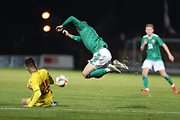 19th November 2019; Ballymena Showgrounds, Ballymena, Antrim County, Northern Ireland; European Under 21 Championships 2021 Qualifier, Northern Ireland Under 21 versus Romania Under 21; Northern Ireland's Alfie McCalmont is up-ended by Marius Marin of Romania  - Editorial Use