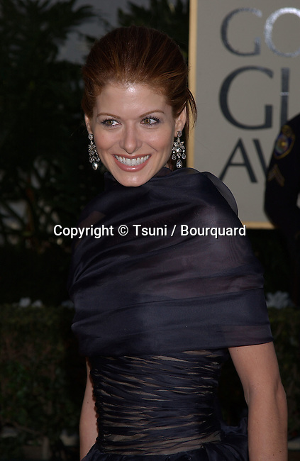 """Debra Messing of """"Will & Grace,"""" arrives at the 59th Annual Golden Globe Awards at the Beverly Hilton Hotel in Beverly Hills, Calif., Sunday, January 20, 2002. She's nominated for best actress in a comedy or musical.           -            MessingDebra02D.jpg"""