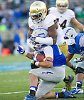 Oct. 26, 2013; Linebacker Jaylon Smith (9) wraps up Air Force Falcons wide receiver Colton Huntsman (14).