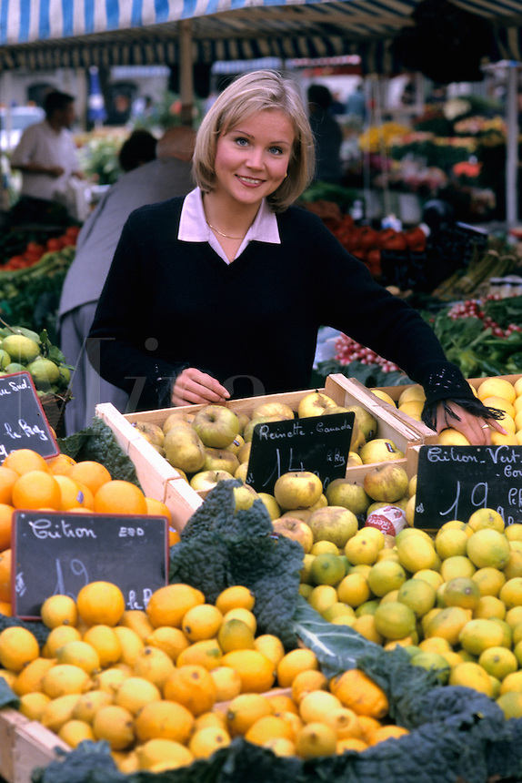 woman shopping at local vegetable market in Nice France