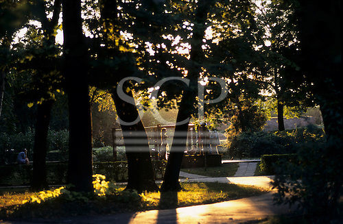 Belgrade, Serbia. Sava Park; delightful autumn or late summer evening light; woman in silhouette walking.