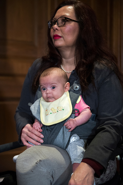 UNITED STATES - JULY 12: Sen. Tammy Duckworth, D-Ill., and her daughter Maile, 3 months, attend a news conference to support women's reproductive rights and defend Roe v. Wade as they relate to the nomination Brett Kavanaugh to the Supreme Court on July 12, 2018. (Photo By Tom Williams/CQ Roll Call)
