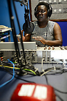UGANDA, Arua, radio station Radio Pacis, Radio reporter ON AIR