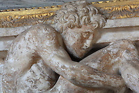 Ephebe in carved stucco from the frame of a fresco by Rosso Fiorentino, 1535-37, in the Galerie Francois I, begun 1528, the first great gallery in France and the origination of the Renaissance style in France, Chateau de Fontainebleau, France. The Palace of Fontainebleau is one of the largest French royal palaces and was begun in the early 16th century for Francois I. It was listed as a UNESCO World Heritage Site in 1981. Picture by Manuel Cohen