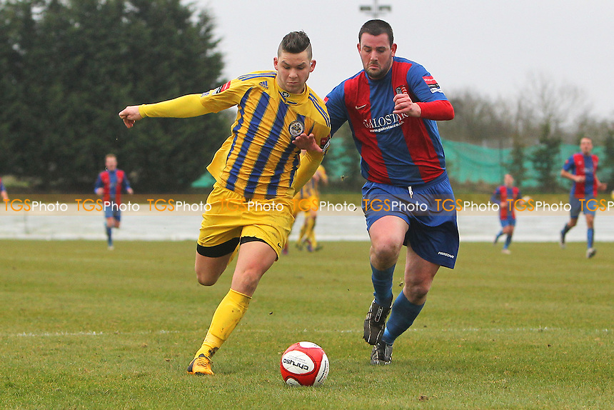 Tom Richardson of Romford tussles with Glen Golby of Maldon  - Maldon & Tiptree vs Romford - Ryman League Division One North Football - 16/03/13 - MANDATORY CREDIT: Gavin Ellis/TGSPHOTO - Self billing applies where appropriate - 0845 094 6026 - contact@tgsphoto.co.uk - NO UNPAID USE.