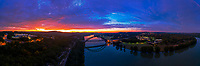 Wow! I captured this spectacular color-drenched aerial panorama of the sun rising over the 360 Pennybacker Bridge in west Austin, Texas. It was a blistering cold December morning, but I wear my thermals and love the quite stillness and beauty of the morning while everyone is still asleep.