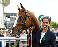 Winner of The Simon & Nerys Dutfield Memorial Novice Stakes  Sybolize and Lass in the Winners Enclosure  during Afternoon Racing at Salisbury Racecourse on 16th May 2019