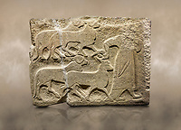 Alaca Hoyuk Sphinx Gate Hittite monumental relief sculpted orthostat stone panel. A figure bringing sacrificial animals.  Anatolian Civilizations Museum, Ankara. Turkey<br /> <br /> The figure wearing a long-tailed cloak holds, with the right hand, the horn of the goat coming from behind.  <br /> <br /> Against a brown art background.
