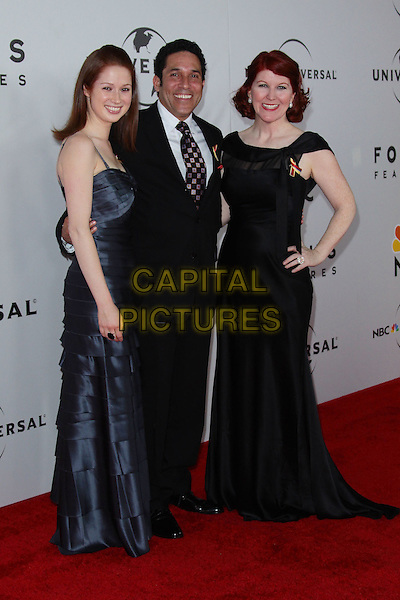 ELLIE KEMPER, OSCAR NUNEZ & KATE FLANNERY.NBC Universal's 67th Annual Golden Globe After Party held at Beverly  Hilton, Beverly Hills, California, USA..January 17th 2010.globes full length black suit dress hand on hip blue silk satin layers layered.CAP/ADM/TC.©T.Conrad/Admedia/Capital Pictures