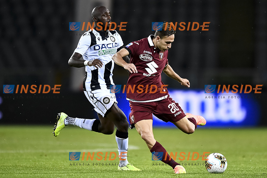 Seko Fofana of Udinese Calcio and Simone Edera of Torino FC compete for the ball during the Serie A football match between Torino FC and Udinese at Olimpico stadium in Torino ( Italy ), June 23th, 2020. Play resumes behind closed doors following the outbreak of the coronavirus disease. <br /> Photo Image Sport / Insidefoto