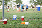CHAD PILSTER &bull;&nbsp;Hays Daily News<br /> <br /> Water bottles sit on the ground on Tuesday, September 10, 2013, during practice of the third grade Gamblers of the Hays Football Association  at Aubel-Bickle Park in Hays, Kansas.