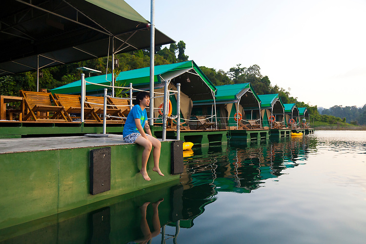 Ranforest Camp Elephant Hills Luxury Floating Tented Camp  located on the Cheow Larn Lake in the rainforest in Southern Thailand.