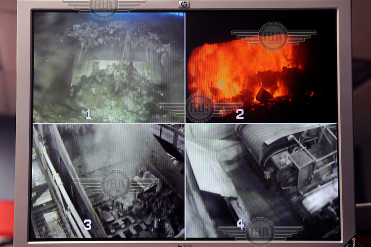 CCTV monitors all parts of the process at Covanta Waste-to-Energy plant, Westbury, New York. The plant feeds rubbish into giant furnaces that produce steam to turn a turbine and produce electricity.