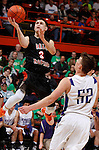 RAPID CITY, S.D. MARCH 20, 2015 -- Zane Schumaker #3 of Dell Rapids flies for a layup in front of defender Brendan Harter #52 of Winner during their semi-final game at the 2015 South Dakota State A Boys Basketball Tournament at the Don Barnett Arena in Rapid City, S.D.  (Photo by Dick Carlson/Inertia)